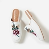 Cheska Floral Embroidered Flat Mule In White Faux Leather