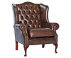 Amerigo Antique Brown Leather Fireside Chair copper studs