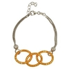 Three gold hoops on a delicate silver chain bracelet