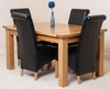 Seattle Extending Dining Table & 4 Black Montana Scroll Top Leather Chairs